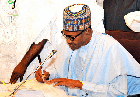 I was forced to sign N9.12trn 2018 budget into law – Buhari