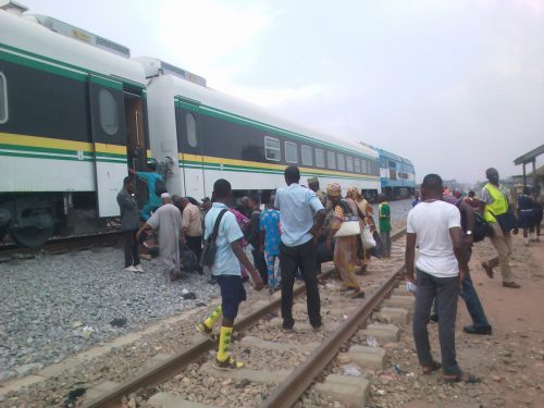 Intending passengers about to board free train ride at Iju station in Lagos on Thursday